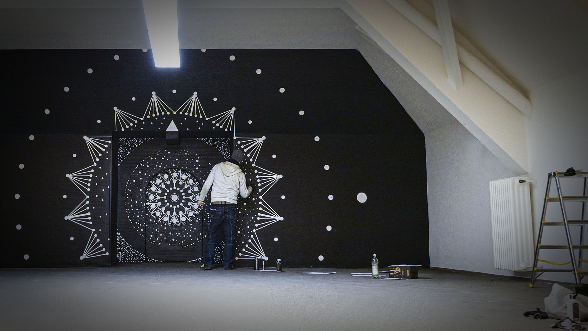 Image of a video art installation and street art mural painting showing a making off scene